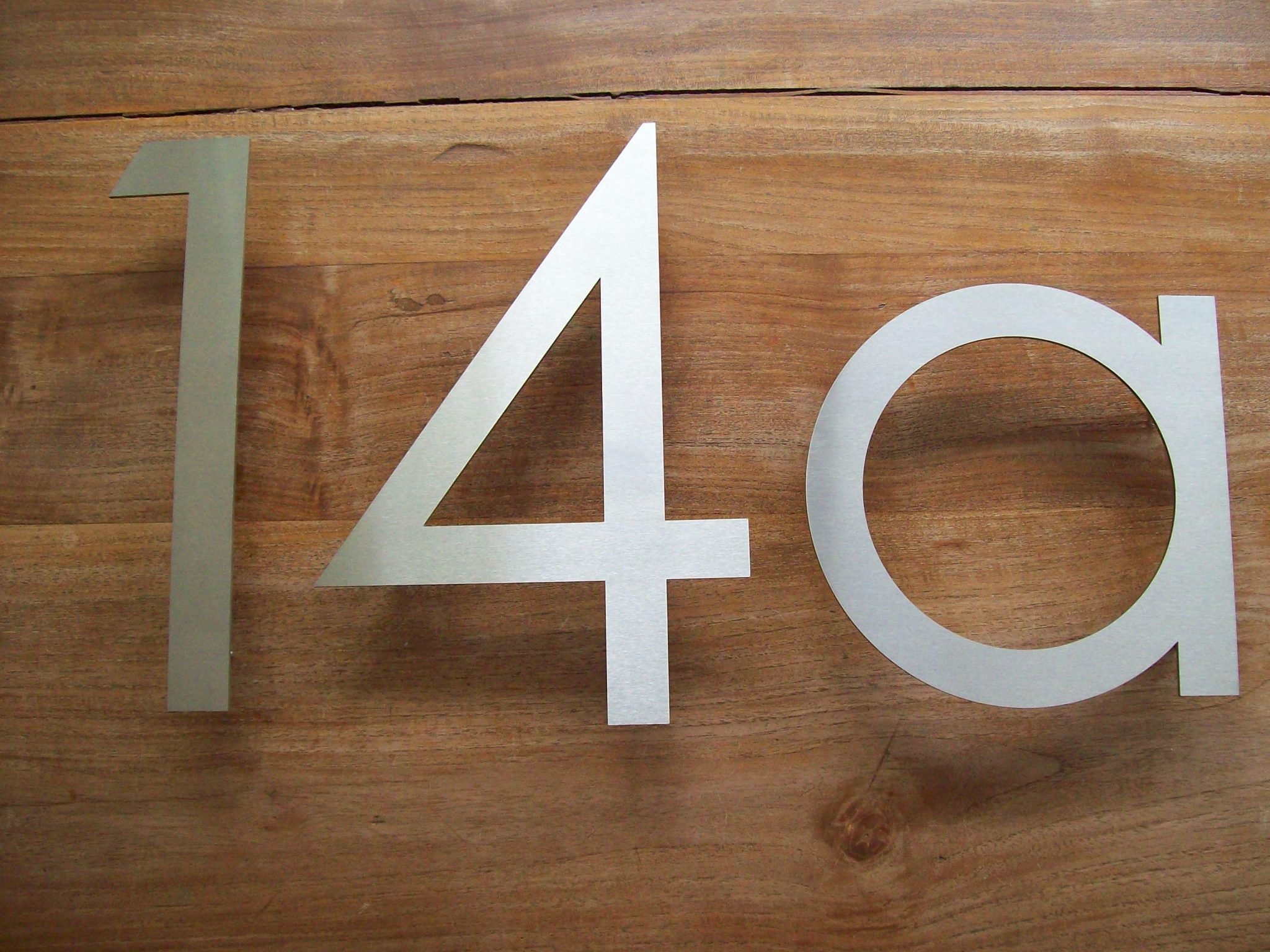 Huisnummer uit losse cijfers RVS316 3mm dik